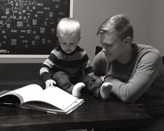 My husband and son, reading Unwrapping The Greatest Gift by Ann Voskamp
